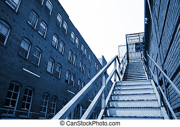 Metal stairway going up in an old downtown building, Los...