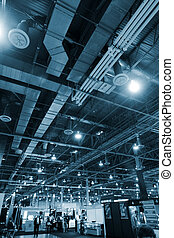 Huge industrial space hosting a trade show.