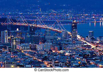 San Francisco bridges at night aerial view from Twin Peaks.