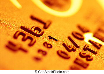 Golden credit card digits close-up