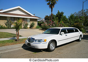 White limousine next to a residential house