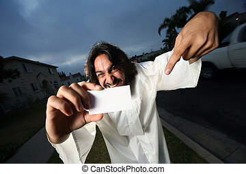 Crazy looking man showing his blank business card