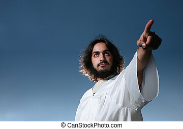 Man looking like Jesus pointing his finger, dramatic blue...
