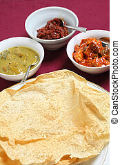 Poppadoms with indian pickles - A plate of Indian pappadums...