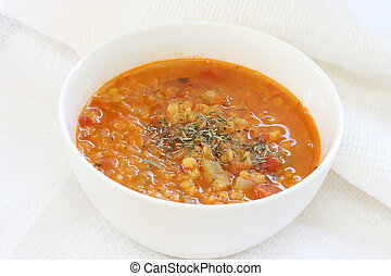 Red lentil soup - View of red lentil soup in white bowl,