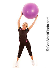 Gym Ball - A female holding a purple gym ball above her head