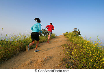 Two people running at Runyon Canyon Park, Hollywood Hills,...
