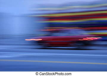Car speeding in the dusk, blurred motion