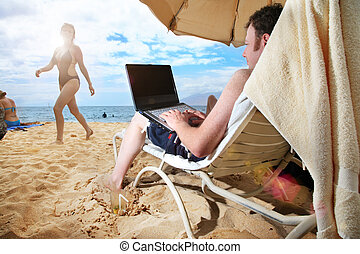 IT guy's vacation - Man working on laptop at tropical beach...
