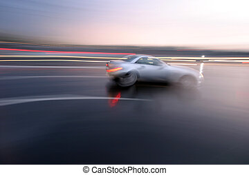 Fast moving sporty car, blurred motion