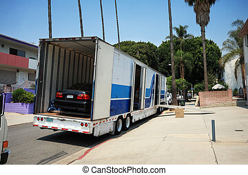 Moving to California - Large moving truck with a car inside...
