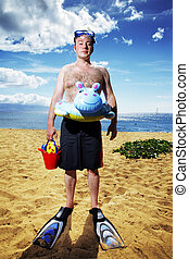 Man ready for fun at sunny tropical beach - Funny young man...