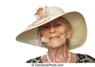 Portrait of a senior woman in retro hat, isolated on white.