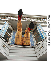 Legs sticking out the window on Haight street. San...