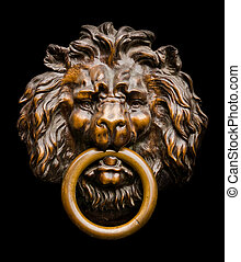 Lion Door Knocker - Close up of an isolated lion-shaped door...