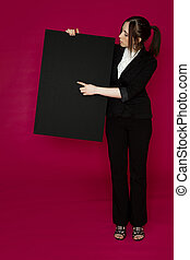 Pointing a point - Young business woman wearing a business...