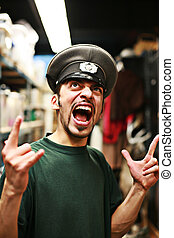 Adult man in military service cap shouting