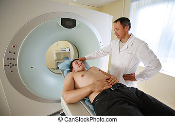 Patient and doctor ready to do CAT scan with CT scanner