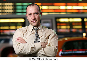 Businessman portrait - Businessman over stock exchange...