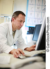 Doctor using computer, portrait
