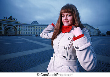 Beautiful young woman at Palace Square, St. Petersburg, Russia.