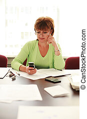 Business woman reading text message on mobile phone