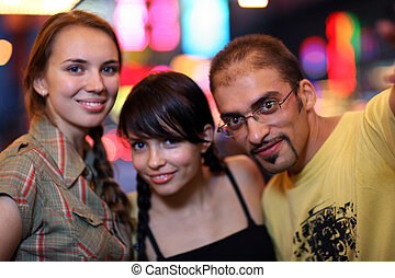 Three friends posing in night city Shallow DOF