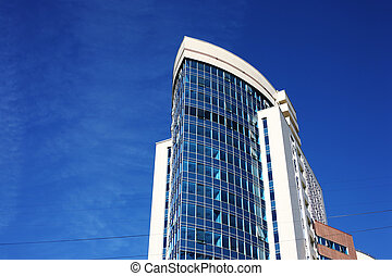Modern office building over blue sky.