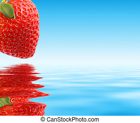Red strawberry over blue water Macro, close-up