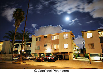 Residential street with apartment buildings at night at Los...