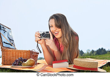 young woman making a picture