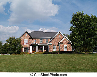 Two story large brick home.