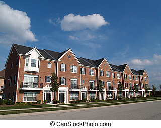 Brick Condos With Bay Windows - A row of brick condos or...