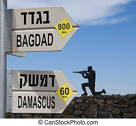 bagdad damascus direction sign with a soldier in the...
