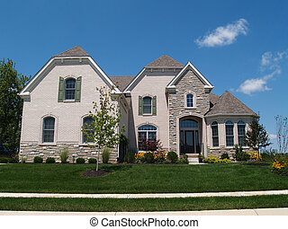Two Story White Brick and Stone Res