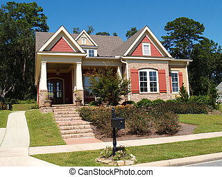 Brick Home With Porch and Gables - Beige brick home having...