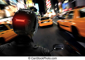 Motorcycle Rider - Motorcycle rider racing on a busy city...