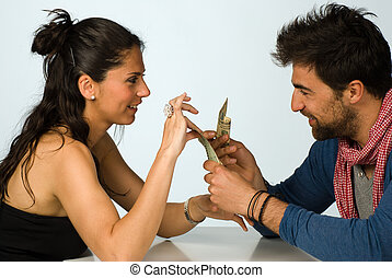 Financial affairs - Couple agreeing on sharing money,...