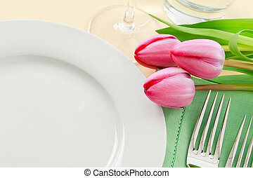 Spring Table Setting - Three pink tulips grace a table...