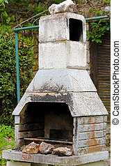 Concrete BBQ - Big concrete BBQ with chimney at back yard
