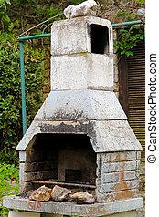 Concrete BBQ - Big concrete BBQ with chimney at back yard
