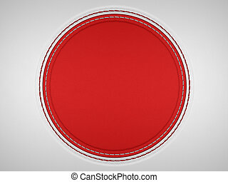 Red and grey stitched circle shape on leather background...