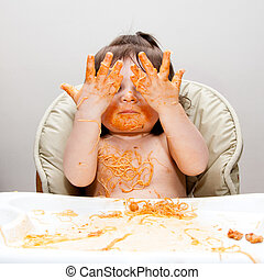 Happy funny messy eater - Happy baby having fun eating messy...