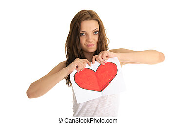 young woman breaks the painted heart isolated on white