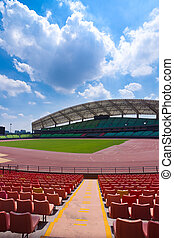 Stadium seats - A field of empty seats in a open stadium in...