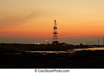Drilling sunset. - Drilling rig at sunset the sun. Western...