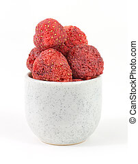 Freeze dried strawberries in small dish - Several freeze...