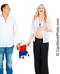 pregnant couple with toy bear