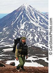 Tourist and vulcano - The Tourist on background vulcano...