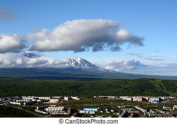 The city and the vulcanos. - Landscape of city Petropavlovsk...